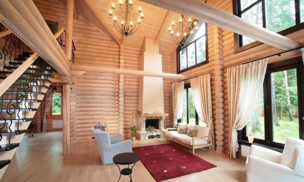 Это интерьер дома из оцилиндрованного бревна. Они внутри чуть выбелены. Фото не передает все прелести, но понять о чем речь можно