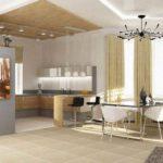 Смежная кухня с гостиной освещены по разному