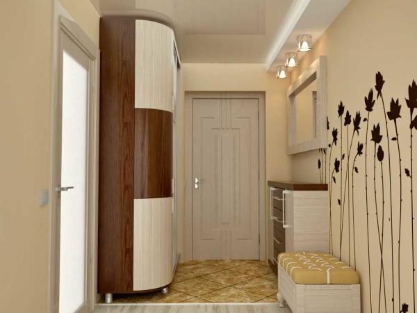 Необычная форма шкафа, мягкие тона бежево-коричневой гаммы. ДИзайн интерьера прихожей мягкий и спокойный