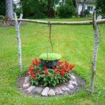 Клумба-костер в саду из цветов