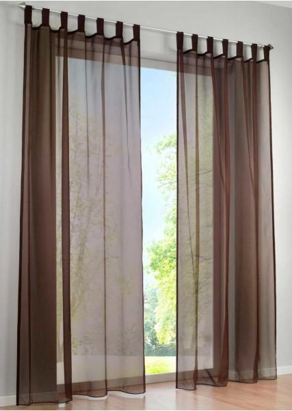 Коричневая вуаль не петлях - отличный вариант для спальни с балконом