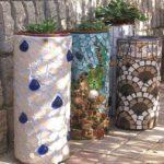 Отделка бетонного вазона кусками плитки