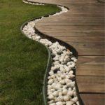 Водоотведение ливневых вод от дома и дорожек можно оформить и так