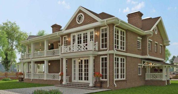 Большой двухэтажный дом из кирпича с двумя открытыми террасами с элементами стиля модерн
