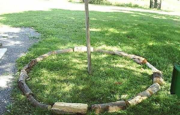 Первый шаг укладки круглой поленицы
