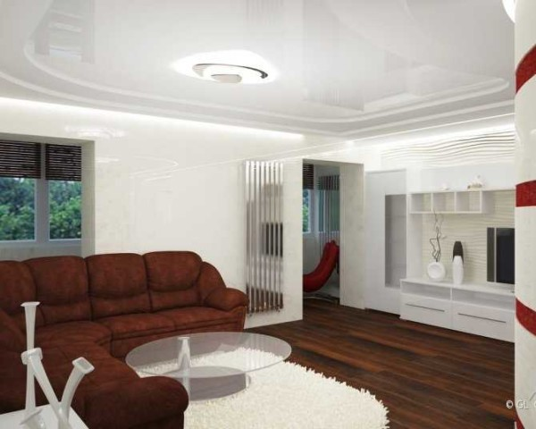 Гостиная. Большой полукруглый диван является центром интерьера. Он занимает центр композиции