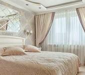Классические шторы в соответствующщем интерьере спальни
