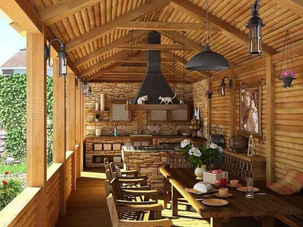 Открытая летняя кухня из бруса, пристроенная к дому