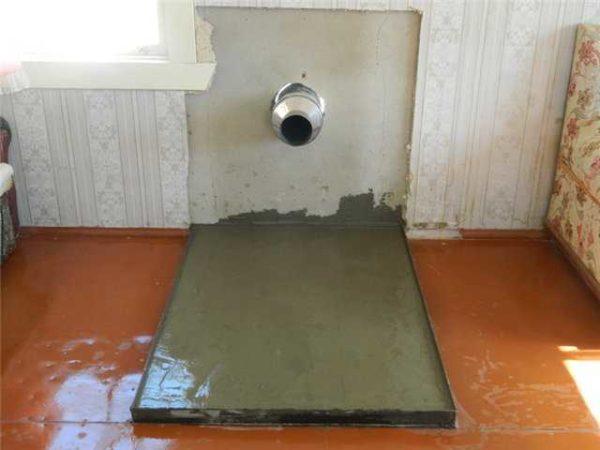 Подготовка места под установку печи и установленный в стену ППУ с куском трубы