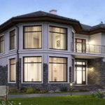 Нестандартна форма дома подчеркивается большими окнами
